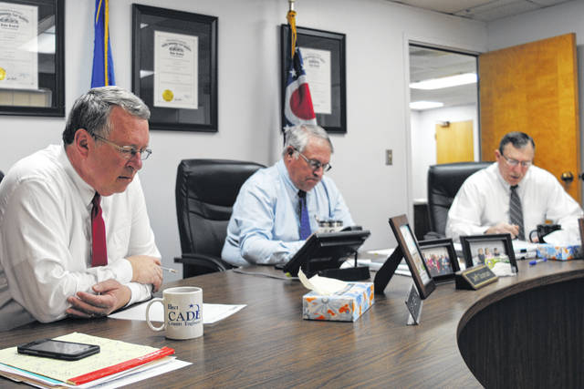 From left, Highland County commissioners Gary Abernathy, Jeff Duncan and Terry Britton meet Wednesday at the Highland County Administration Building.