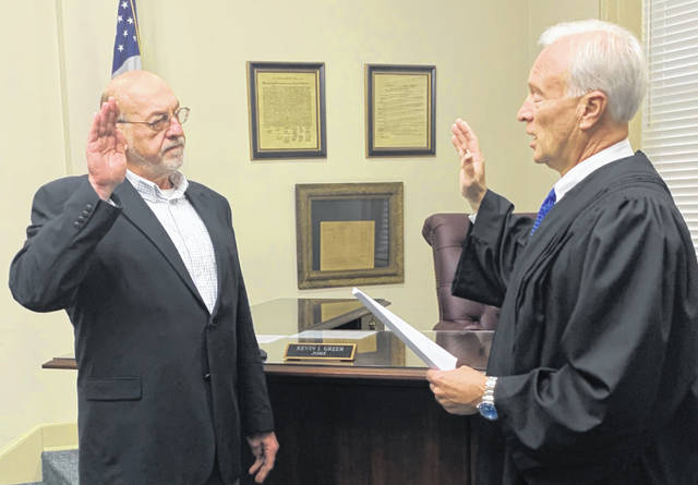 Tom Eichinger, left, is sworn in Wednesday morning as president of Hillsboro City Council by Judge Kevin Greer, right. Members of the Highland County Republican Central Committee on Tuesday nominated Eichinger to replace former Council President Lee Koogler, who resigned in March. Eichinger, a local Republican, is resigning as chairman of the Hillsboro Planning Commission to take the seat, and he will campaign to keep it in the November General Election, officials said.