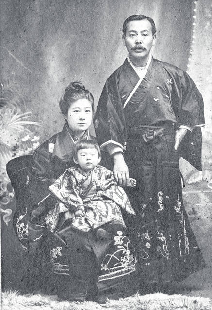 "This photo, one of dozens of undated, unidentified pictures kept by the Highland County Historical Society, appears to depict a family wearing traditional Asian garb posing for a snapshot. To the best of our understanding, an inscription on the back reads ""Paul + Koh to Ashida."" A faded stamp on the back shows the address 1128 Pacific Ave., Tacoma, Wash. Do you know who they are? Where the photo might have been taken? When it might have been taken? We're interested. Call us at 937-393-3456, email us at HTGinfo@timesgazette.com or visit us on Facebook at www.facebook.com/TheTimesGazette."