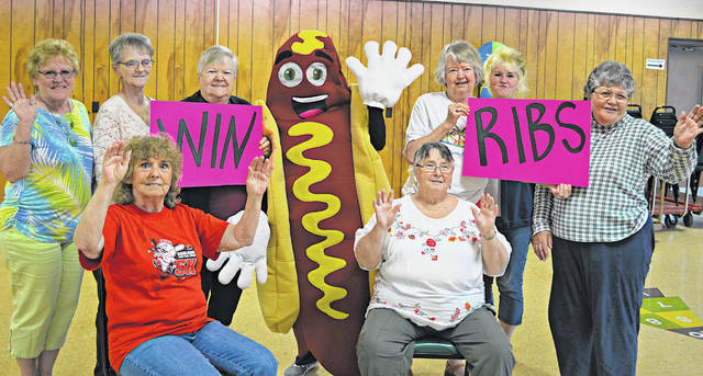 Highland County Senior Citizens Center members pose for a photo for an upcoming bingo event with Mr. Hot Dog. The members are (seated, l-r) Jackie Noble and Patty Ziesemer; and (standing, l-r) Sue Thornhill, Judy McCray, Sylvia Clark, Ruth Spendlove, Joy Fetters and Janice Myers.
