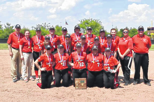 The Fairfield Lady Lions pose for a team photo with their 2019 Southeast District Championship trophy on Saturday at Unioto High School where the Lady Lions beat the Wheelersburg Lady Pirates 8-5 to advance to the Regional Tournament in Lancaster.
