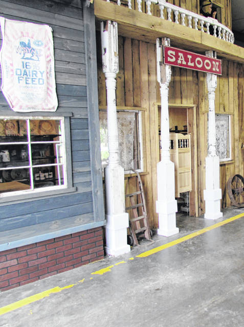 An old-fashioned wild west theme greets those using the drive-through at Faith's Fancy Feeds on U.S. Route 62 just north of Hillsboro. The grand opening is Saturday from 10 a.m. to 5 p.m.