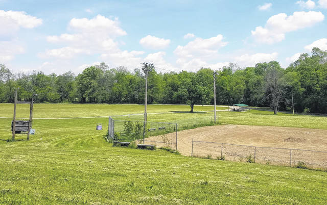 The blank canvas of Felson Park is pictured, as seen from McArthur Way. The ball diamond can be seen, as well as the shelter with picnic tables provided by Grow Greater Greenfield.