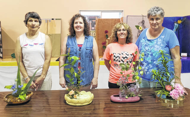 Pictured, from left, with their Moribana arrangements are Liz Stritenberger, Judith Stinvender, Shelly Rayburn and Nancy Baldwin.