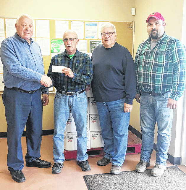 Members of the Good Hope Lions Club are pictured making a $1,000 donation to the Greenfield Area Christian Center Food Pantry. Pictured, from left, are David Ross of the Good Hope Lions, Danny Long and Lanny Bryant representing the food pantry, and Jerred Posey of the Good Hope Lions.