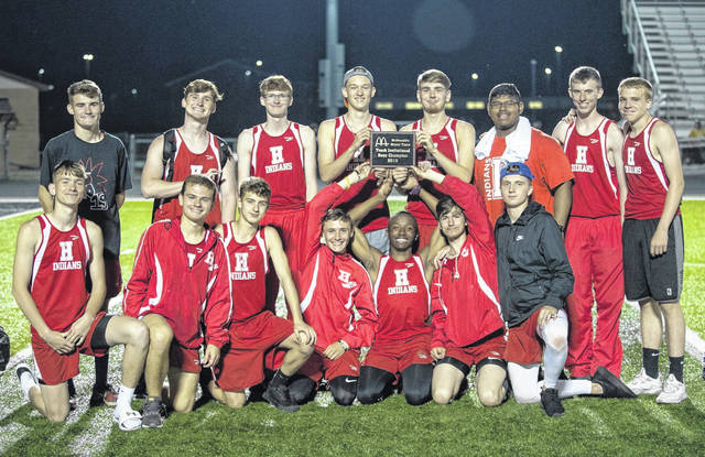 Members of the Hillsboro boys Track and Field team pose for a picture with the first place plaque from the Miami Trace Invitational held on Thursday, May 2, at Miami Trace High School.
