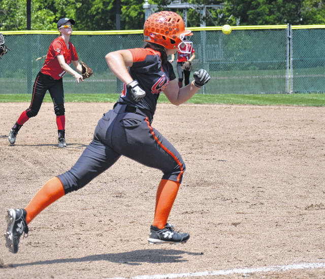 Fairfield Freshman Halle Hamilton throws to first base in the bottom of the fourth inning on Saturday as the Meadowbrook batter runs to first during the D III Regional Softball Final.