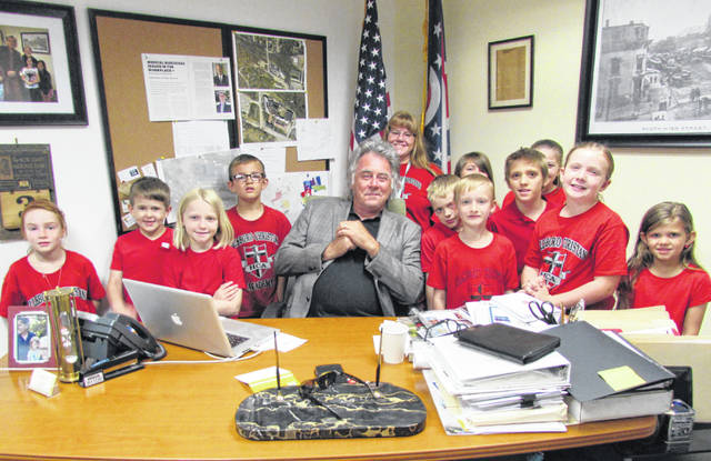 The second grade class of the Hillsboro Christian Academy paid a visit to Hillsboro Mayor Drew Hastings Wednesday in what their teacher, Lynette Tracy, described as a teachable moment about community and leadership. Pictured, from left, are Gloria Brock, Mason Ross, Ava Gorman, Braxton Henderson, Hastings, Tracy, Andrew Strout, Lorissa Rhoden, Colton Lindsey, Jeremiah Hatfield, Macy Whitman, Lena Moenster and Emmalynn Kelley.