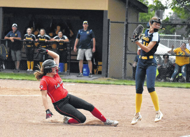 Fairfield's Layla Hattan slides into third base on a triple in the bottom of the fourth inning on Thursday at Unioto High School where the Lady Lions took on the Lady Golden Rockets of Wellston in a D III Southeast District Semi-Final tournament game.