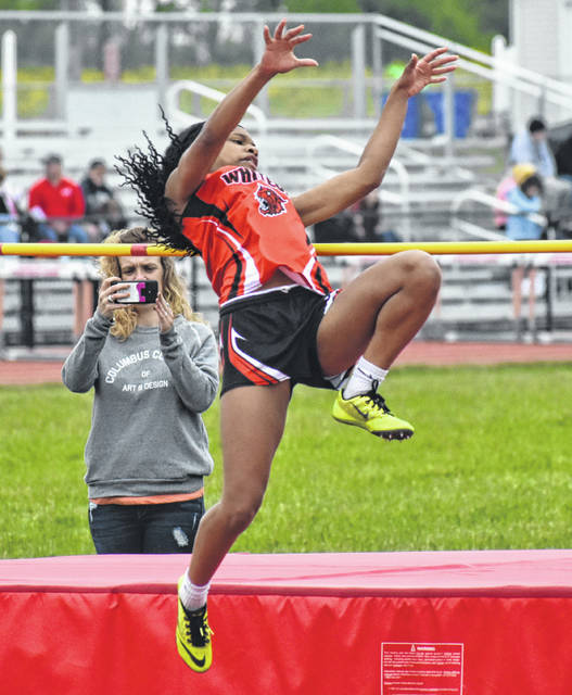 Whiteoak's Kensley Bailey jumps over a height of 4-10 on Friday at Fairfield High School where the Southern Hills Athletic Conference Championships were held.