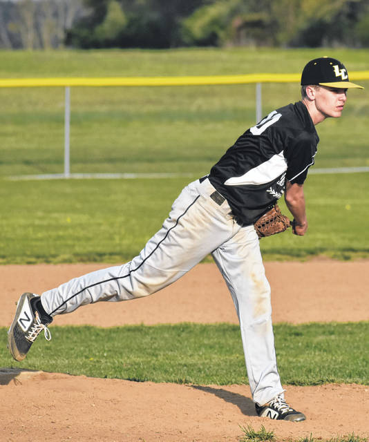 In this Times-Gazette file photo from Thursday, April 18, Lynchburg-Clay's Alex Barber throws a pitch against the Whiteoak Wildcats at Lynchburg-Clay High School.
