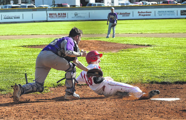 McClain's Colton Mossbarger tags Hillsboro's Dylan Boone at the plate on Monday at Shaffer Park in Hillsboro where the Indians hosted the Tigers in the final FAC game of the season for both teams.