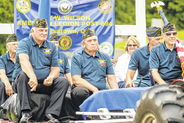Members of the Roy W. Wilson American Legion Post 694 in Mowrystown and the Whiteoak High School band are pictured during Memorial Day activities Monday in Mowrystown.