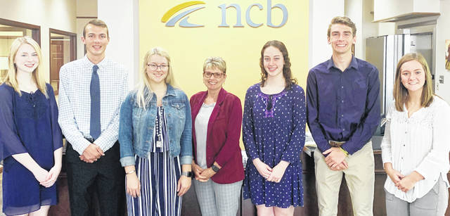 NCB's Deb Jones recently awarded six high school seniors with scholarships. Winners of the Money Matters Financial Literacy Scholarship were Larkyn Parry, Atlee Carr and Kelsey Arnett. Winners of the Ernie Blankenship Athletic Scholarship were Sydney Bobbitt, Brandston Duffie and Rachel Schuler.
