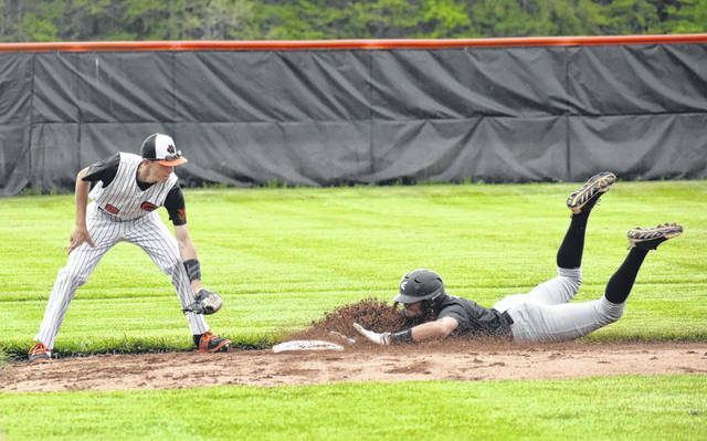 Whiteoak's Ryan Roberts attempts to apply the tag at second base as a Miami Trace player slides head first on Tuesday at Whiteoak High School where the Wildcats took on the Panthers in a non-league post season tune up game.
