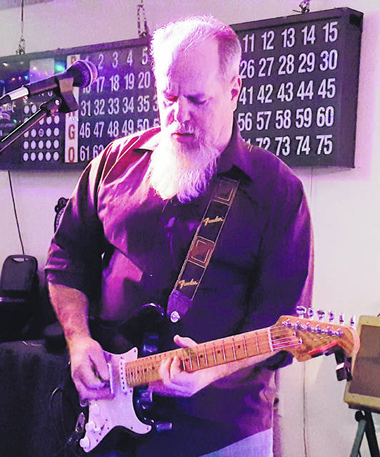 Ron Adams, pictured here playing in Hillsboro, passed away Feb. 14. A benefit concert will be held for his family June 8 at the former Amvets Park on North Shore Drive.