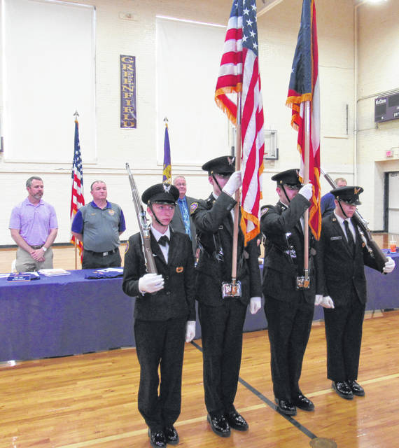 Cadet Corps members hold the American and state flags as they helped to start off Monday's Greenfield Board of Education meeting. School boards members Eric Zint and Jason Allison, as well as interim superintendent Ron Sexton are seen in the background.