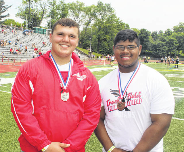 Hillsboro's Draven Stodgel (left) and Deon Burns each qualified for the OHSAA State Track and Field Championships. Stodgel qualified with a Regional Championship best discus throw of 169 feet and also earned a spot in the boys shot put event with a second place finish. Burns took fourth in the shot put to earn his spot at the State Championship.
