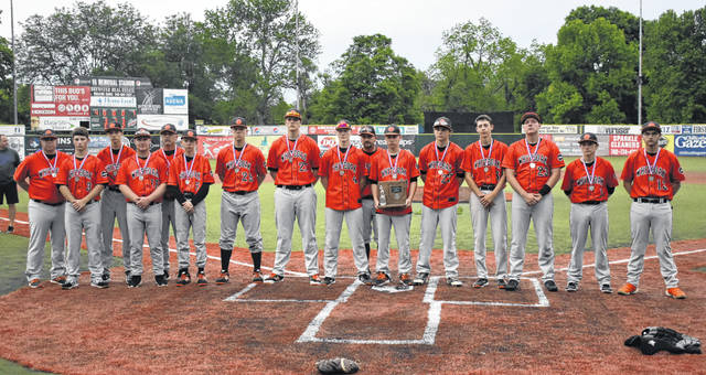 The Whiteoak Wildcats varsity baseball team poses for a team photo with their District runner up medals and trophy on Wednesday at VA Memorial Stadium in Chillicothe. Pictured (l-r): Assistant Coach John Combs, Zach Harless, Michael Igo, Kyler Emery, Head Coach Chris Veidt, Connor Butler, Trey Bogart, Mason Lehr, Traeten Hamilton, DJ O'Cull, Chase Butler, Ty Large, Ryan Roberts, Evan Brill, Billy Oliver and Jaycob Gross.