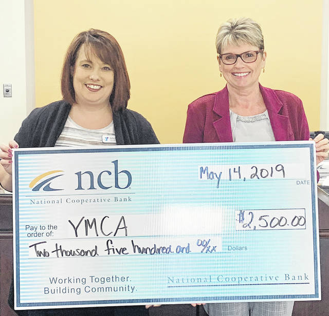 NCB donated $2,500 recently to the Highland County Family YMCA. The money will be used for the Y's Summer Day Camp program for youth. Pictured are Kelly Kiser, left, YMCA director, and Deb Jones, NCB co-president, Ohio Region.