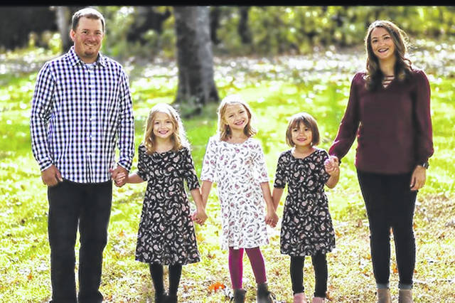 Shown is Ashley Davis, right, and her family. Davis was critically injured in a car accident this week.