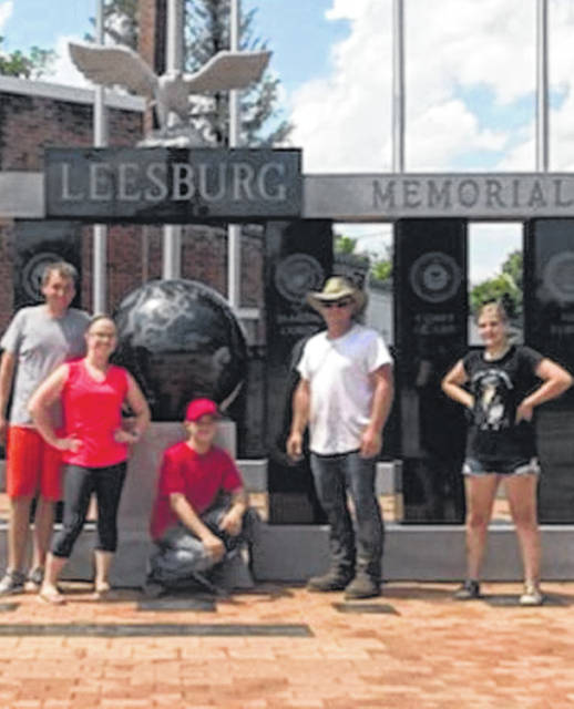 Brad Chaney, Cheyenne Harris, Aden Thackston, Butch Wiget and Morgan Wiget are shown at a cleanup day in Leesburg May 18. Volunteers assembled in the downtown area at 8:30 a.m. and picked up trash, swept the streets and sidewalks and pulled weeds. In addition, the volunteers power washed the Veterans Memorial, cleaned all the stone, planted flowers and mulched. The cleanup day was organized by Cheyenne Harris, owner of Elite Power Tumbling and Cheer. The village would like to thank Dianna Fordyce and Summer Howard for their donations. Not pictured are Kenny Worley, Blythe Pelham, Tracy Evans, Lindsey Collins, Abby Collins and Jim Harris.