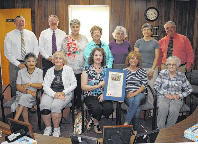 Highland County commissioners pause for a photo with members of the Hillsboro Garden Club Wednesday morning after issuing a proclamation commending the garden club for its 90th anniversary.