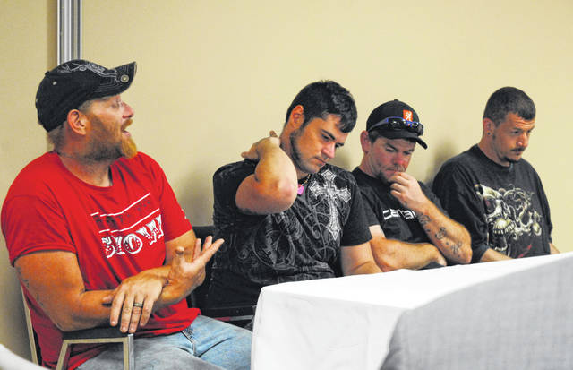 From left, William Penix, Wade Stratton, Eli Bray and Joshua Brannon are shown speaking to the Highland County Drug Abuse Prevention Coalition.