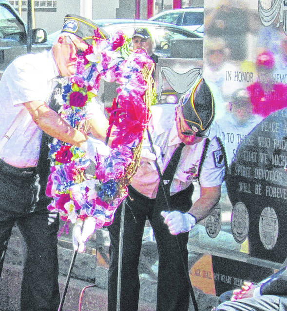 Dwight Reynolds and Dave Pinney of Hillsboro VFW Post 9094 place a wreath at the Highland County Veterans Memorial during past Memorial Day services.