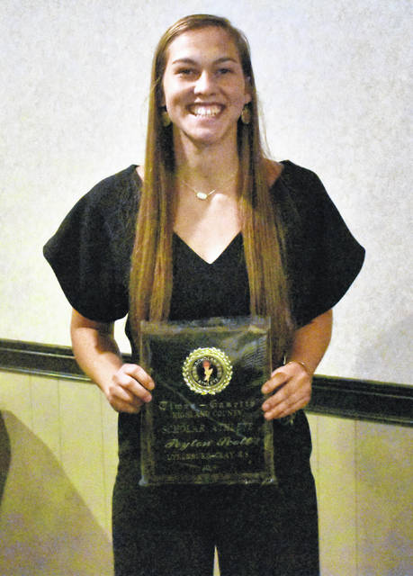Lynchburg-Clay graduate Peyton Scott poses for a picture with her 2019 Times-Gazette Highland County Scholar Athlete of the Year plaque on Thursday at the 10th Annual Highland County Hall of Fame Banquet in Hillsboro.