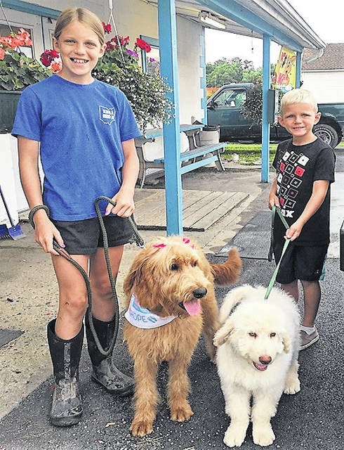 All ready for Saturday's Bark in the 'Boro are, from left, Kailyn Greer with Jax, and Josie wanting to go for a walk with Kyson Greer.