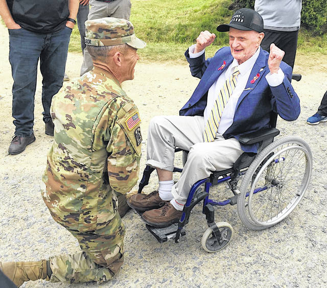 Shane Fligor talks to 93-year-old World War II veteran Carl Felton. Both men were in the Normandy region of France for the 75th anniversary of D-Day.