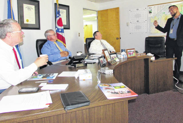 Left to right, commissioners Gary Abernathy, Jeff Duncan and Terry Britton listen a presentation from Census Bureau Specialist Samuel Knight at a Wednesday meeting.