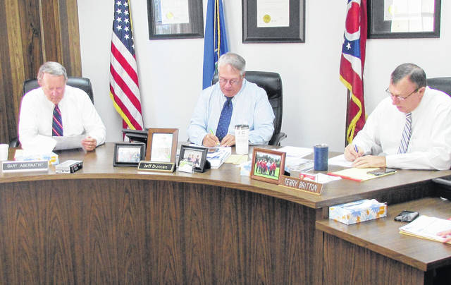 Shown, from left, are Highland County commissioners Gary Abernathy, Jeff Duncan and Terry Britton during Wednesday's meeting.
