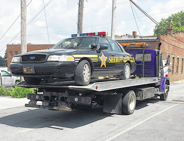 A Highland County Sheriff's Office cruiser is towed from the scene after it was vandalized early Thursday morning around the Highland County Courthouse.