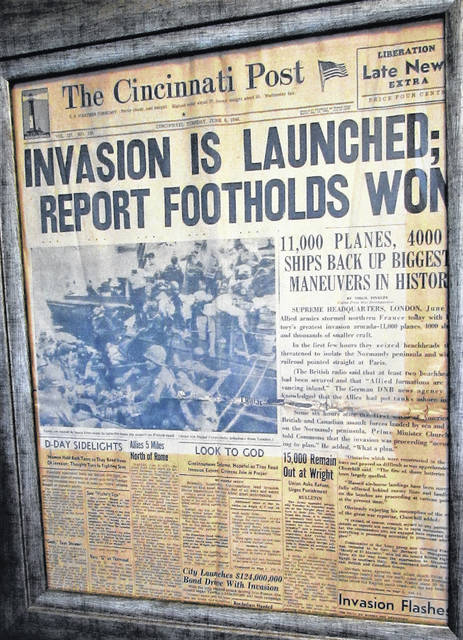 The front page of the Cincinnati Post on D-Day, June 6, 1944, is framed as it hangs in a hallway at Hillsboro VFW Post 9094.