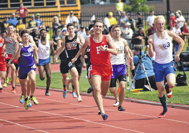 Fairfield Senior Brandtson Duffie passes East Canton's Colt Hemphill for first place on Saturday at Jesse Owens Memorial Stadium on the campus of OSU coming down the home stretch in the D III Boys 800-meter run at the 2019 OHSAA State Track and Field Championships.