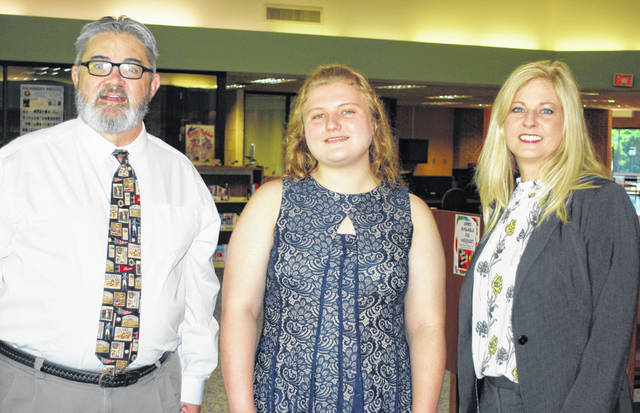 Dan Pearce, Hillsboro Elks grants and scholarship coordinator (left), and Dr. Nicole Roades, SSCC vice president of academic affairs (right), present the 2019 Hillsboro Elks Scholarship to Madison Edwards.
