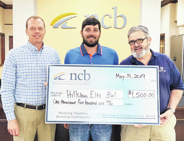 NCB recently donated $1,500 to the Hillsboro Elks Club. The money will be used for the Impact-A-Life Program, which provides developmentally disabled high school students with job training. NCB's Rodney Donley, left, and Steven Evans, center, present a check to Dan Pierce of the Hillsboro Elks.