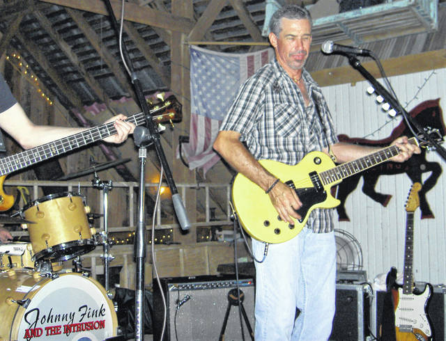 Johnny Fink is pictured performing during a past concert at The Fling Barn, south of Hillsboro.