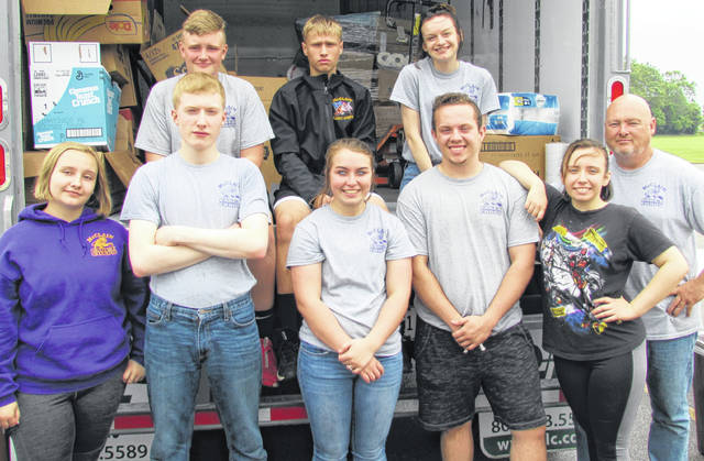 Members of the McClain High School Cadet Corps assisted with relief efforts for Dayton-area residents hard hit by the Memorial Day tornados. Helping to load supplies Wednesday in the parking lot of the Southern State Community College Central Campus in Hillsboro were (front row, l-r) Aurora Thompson, Landon Harter, Brianna Van Dyke, Taiyler Shumaker, Natasha Thompson and Corps Instructor MSgt. John Wilson (USAF/Ret.); (back row, l-r) Malaki Hayburn, Landon Wheeler and Sydney Woods.
