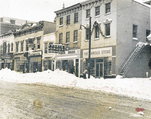 A couple weeks ago The Times-Gazette published this photo of the former The Famous Store, the building on the far right in the photo that was located at 119 W. Main St. in Hillsboro and collapsed on June 3 this year. We asked if anyone could tell us anything about the photo. As it turns out, the picture was taken in December of 1954. The man in the light-colored jacket is Donald Lee Rhoads, who worked at the store at the time and had put up the Christmas decorations on the exterior of the building's second floor. Rhoads was chopping ice off the sidewalk in the picture, according to his son. The other man in the photo is Roger Ports.