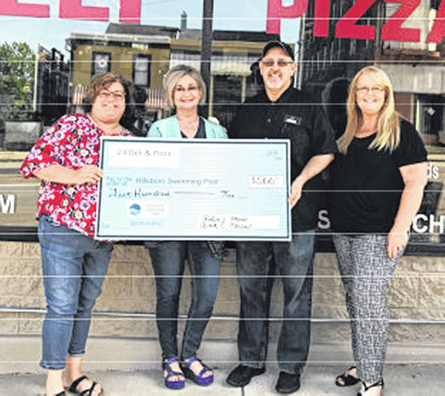 24 Deli & Pizza Bronze recently made a $500 donation to the Hillsboro Swim Club capital campaign. Pictured, from left, are Jennifer Howland, pool board treasurer; Ann and Robin Morris, business owners; and Kelly Smith, Team Bagshaw/sponsorship campaign coordinator.