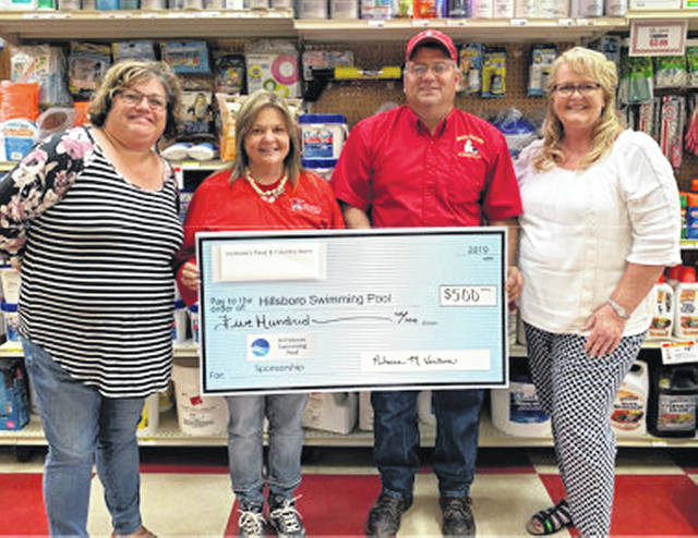 Ventura's Feed & Country Store Bronze recently made a $500 donation to the Hillsboro Swim Club as part of a capital camgaign. Pictured, from left, are Jennifer Howland, pool treasurer; Becky and Steve Ventura, store owners and Kelly Smith, Team Bagshaw/campaign coordinator.