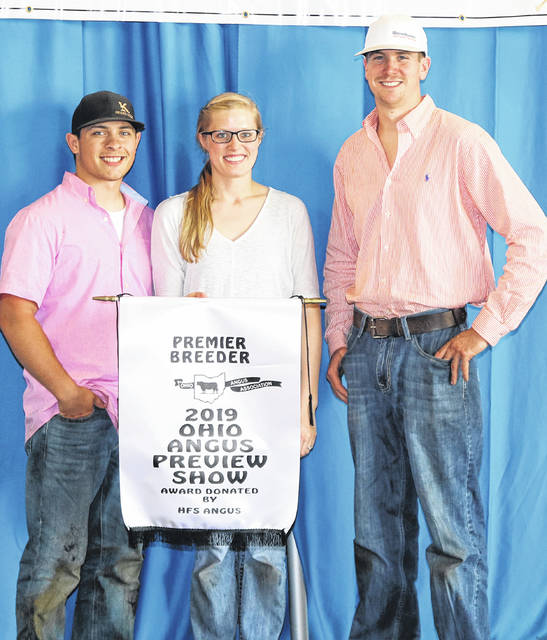 Maplecrest Farms, Hillsboro, won premier breeder at the 2019 Ohio Angus Association Junior Preview Show, June 2 in Caldwell, Ohio. Pictured, from left, are Nick Roach, Lauren Grimes and Will Coor.