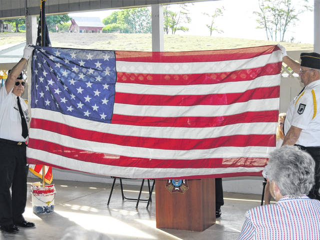 Left to right, Dwight Reynolds and John Walker present the colors during Friday's Flag Day ceremony prior to VFW Post 9094 Commander Rick Wilkin's description of the significance and meaning of the flag's 13-folds.