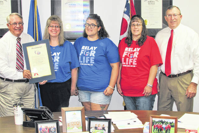 Acknowledging that every family has been directly or indirectly touched by cancer, the Highland County Board of Commissioners proclaimed the week of June 17-21 as Relay for Life Week during their weekly Wednesday meeting. Shownm, from left, are commissioner Jeff Duncan, RFL Co-chair Angie Moots, volunteers Elizabeth Jarjapka and Kristi Jarjapka, and commissioner Terry Britton.