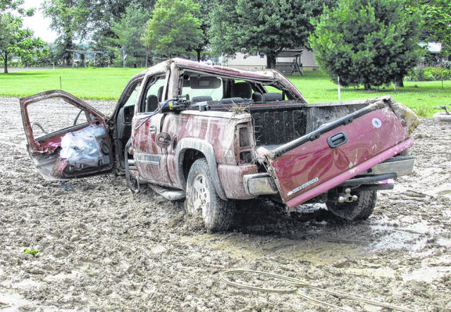 A 2006 Chevrolet Silverado rests in a muddy field on SR 131 near Harwood Road following a rollover accident Tuesday afternoon.