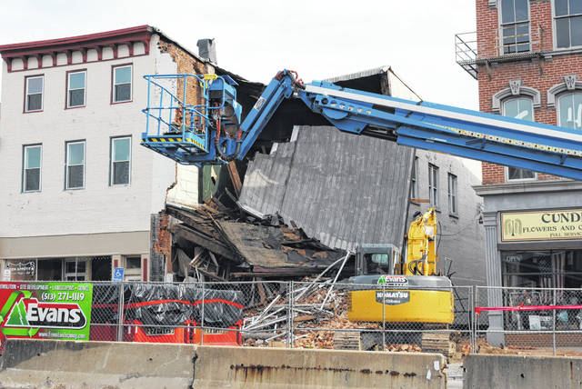 Cleanup equipment is shown at the scene of a collapsed building on West Main Street in Hillsboro.