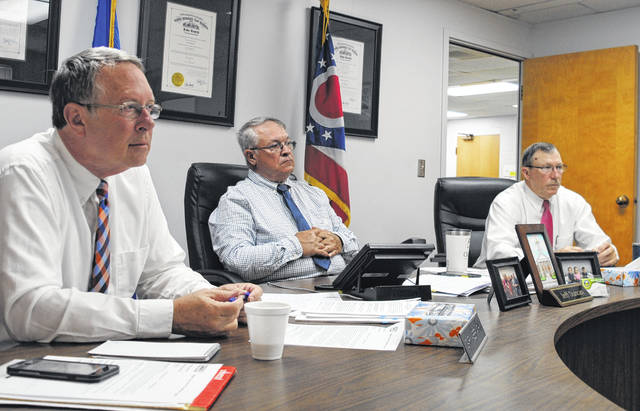 From left, Highland County commissioners Gary Abernathy, Jeff Duncan and Terry Britton sit in session during a weekly commissioners meeting Wednesday.